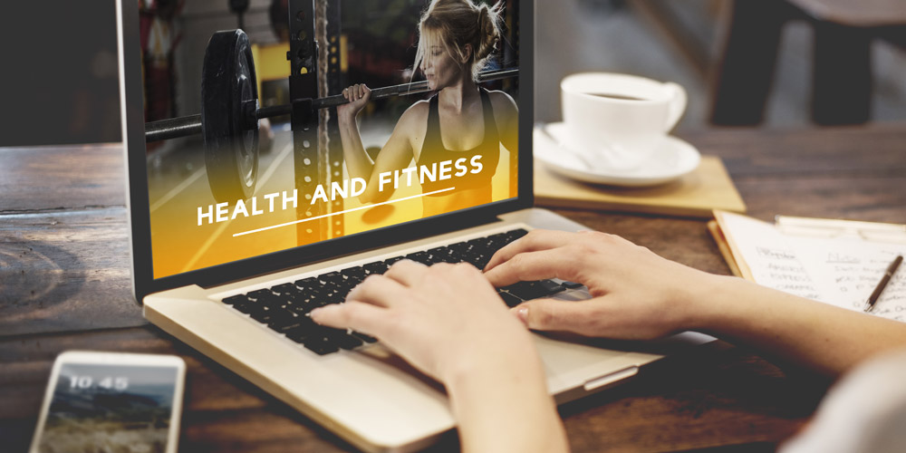 lady searching online ways to bring in new leads for her fitness business